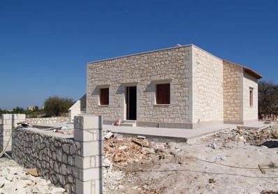 Construction of Houses in Punjab Kachi Abadis